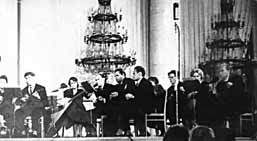 The performance of the orchestra of folk instruments at the stage of Colonnial Hall of the Union House in Moscow